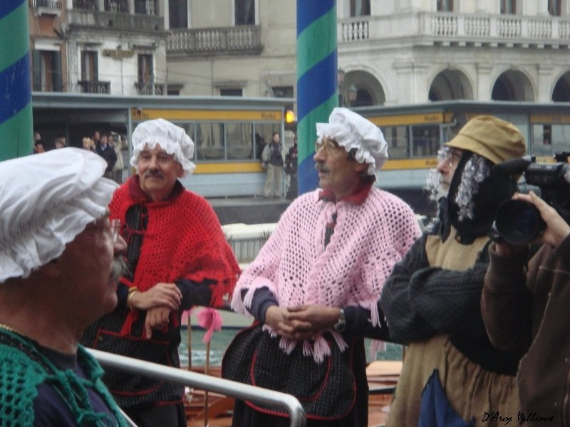 photo of 'witches' at the Regatta della Befana, Venice. The 'befane' relax after the race